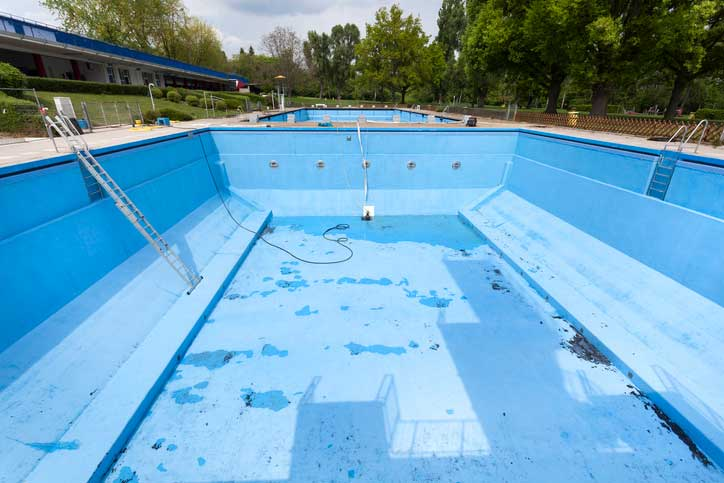Large outdoor pool drained.